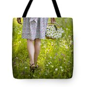 Woman Walking Through A Wild Flower Meadow With A Basket Of Flow Tote Bag