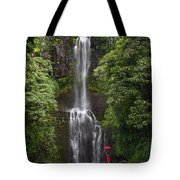 Woman With Umbrella At Wailua Falls Tote Bag
