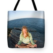 Yoga On Rocky Outcrop Above Ocean Tote Bag