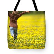 Young Boy Running Through Field Of Tote Bag