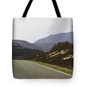 Highway Running Through The Wilderness Of The Scottish Highlands Tote Bag