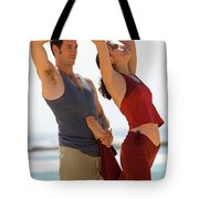 A Man And Woman Practicing Yoga Tote Bag