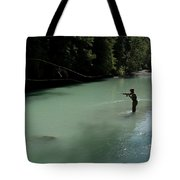 A Man Casts In A River Wearing Waders Tote Bag