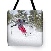 A Skier Descends A Snowy Slope Tote Bag