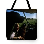 A Woman Sits In Her Safari Jeep Tote Bag