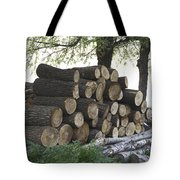 Cut Tree Trunks Piled Up For Further Processing After Logging Tote Bag