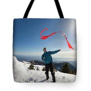 Flying A Kite On A Snowy Mountain Tote Bag