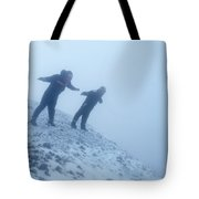 2 Men Leaning Against The Freezing Wind Tote Bag