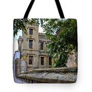Peek Through The Tree's Of Old City Jail Tote Bag