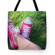 Pink Sneakers On Girl Legs On Grass Tote Bag