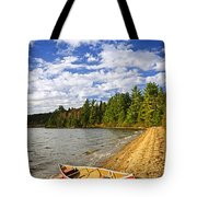 Red Canoe On Lake Shore Tote Bag by Elena Elisseeva
