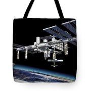 Space Station In Orbit Around Earth Tote Bag by Leonello Calvetti