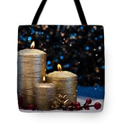 Three Gold Candles In Snow  Tote Bag