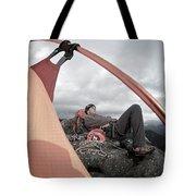 A Man Setting Up A Tent Tote Bag