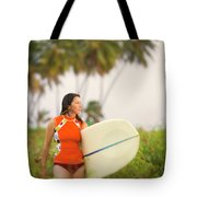 A Woman Carries A Surfboard To The Beach Tote Bag