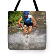 A Woman Mountain Bikes Along Trail 401 Tote Bag