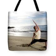 A Women At The Beach Performing Yoga Tote Bag