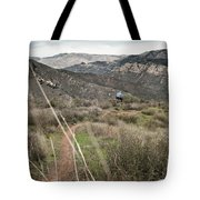 A Young Man Rides His Downhill Mountain Tote Bag