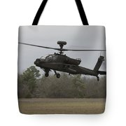 An Ah-64 Apache Helicopter In Midair Tote Bag