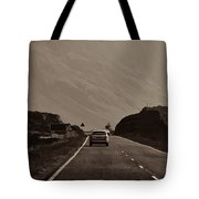 Cars And Other Vehicles On A Road In The Scottish Highlands Tote Bag