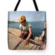 Rock Climbing On Oceanside Cliffs Tote Bag