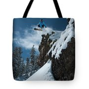 A Male Snowboarder Wearing A Bright Tote Bag
