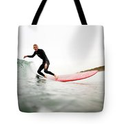 A Surfer Enjoys The Waves In Carlsbad Tote Bag