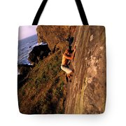 A Man Is Bouldering Near The Ocean Tote Bag