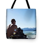 A Athletic Man Sits And Looks Tote Bag