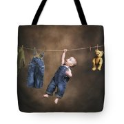 A Baby On The Clothesline Tote Bag