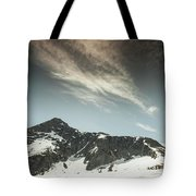 A Backpacker Gazes Up At Needle Peak Tote Bag