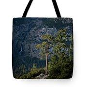 A Backpacker Hikes Down A Trail Tote Bag