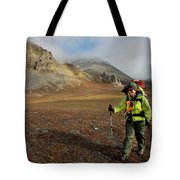 A Backpacker Makes Her Way Tote Bag