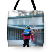 A Boy Rides His Skateboard In Lake Tote Bag