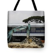 A Bulldozer Moving Dug Out Concrete And Fresh Earth Below The Concrete Tote Bag