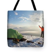 A Camper Lifts His Hand In The Air Tote Bag