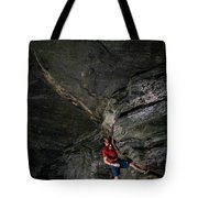 A Climber On A Rock Face Tote Bag