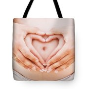 A Couple Making A Heart Shape On The Pregnant Belly With Their Hands Tote Bag