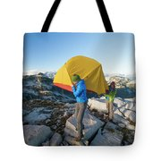 A Couple Of Backpackers Carry Tote Bag