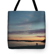 A Couple Walk Along The Shore Tote Bag