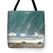 A Cruise Ship Passes By A Wolf Roaming Tote Bag