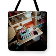 A Cupboard With A Blue Typewriter Tote Bag