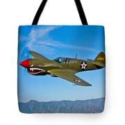 A Curtiss P-40e Warhawk In Flight Tote Bag