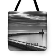 A Curving Pier With A Lighthouse At The Tote Bag