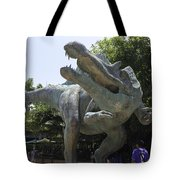 A Dinosaur Exhibit With Visitors In The Universal Studios Singapore Tote Bag
