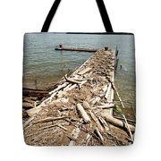 A Dock Covered With Driftwood Tote Bag