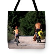 A Father And Son Ride Their Bikes To Go Tote Bag