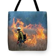 A Firefighter Ignites The Norbeck Prescribed Fire. Tote Bag