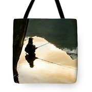 A Fly Fisherman Standing In A River Tote Bag