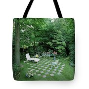 A Garden With Checkered Pavement Tote Bag